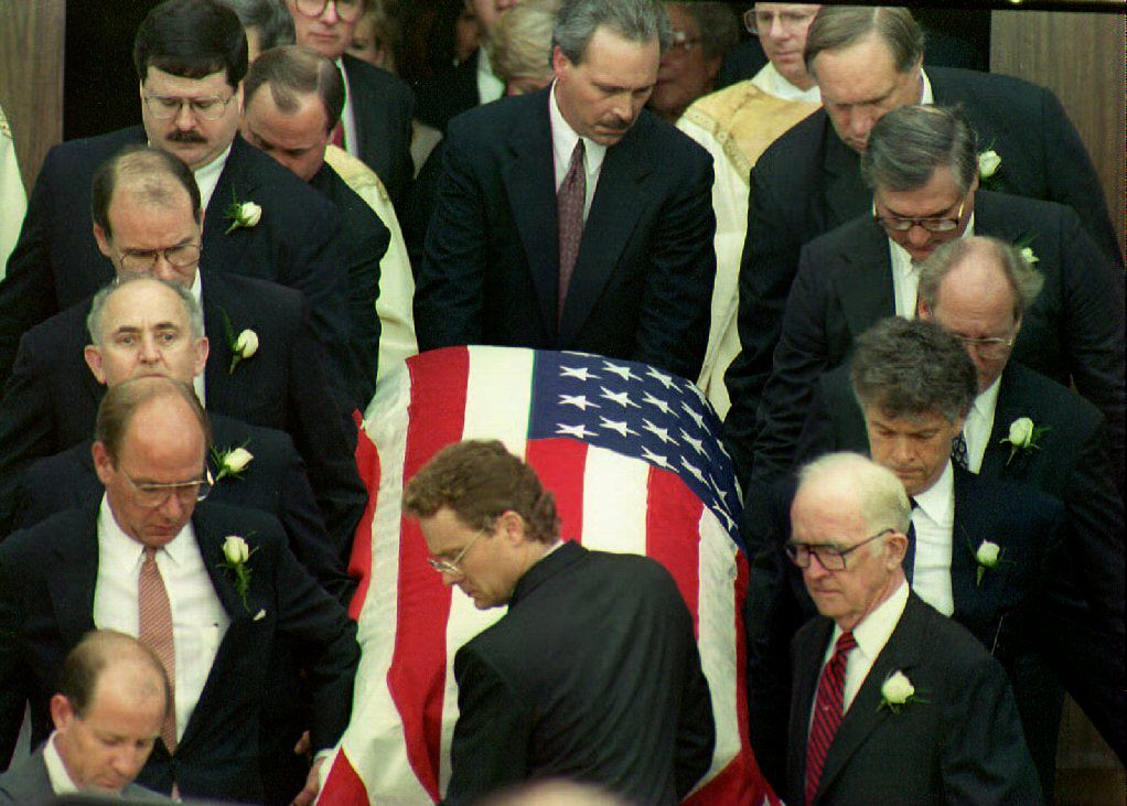 Pallbearers remove the casket of deputy White House counsel Vince Foster Jr.