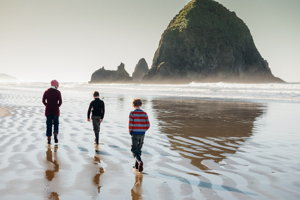 people walking on Cannon Beach