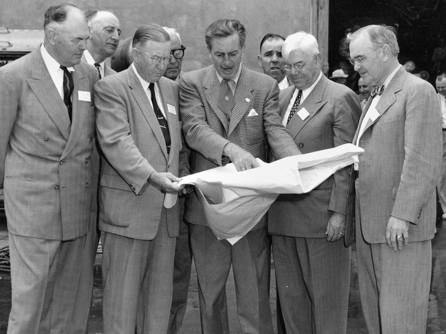 Walt Disney shows Disneyland plans to Orange County officials in December 1954.