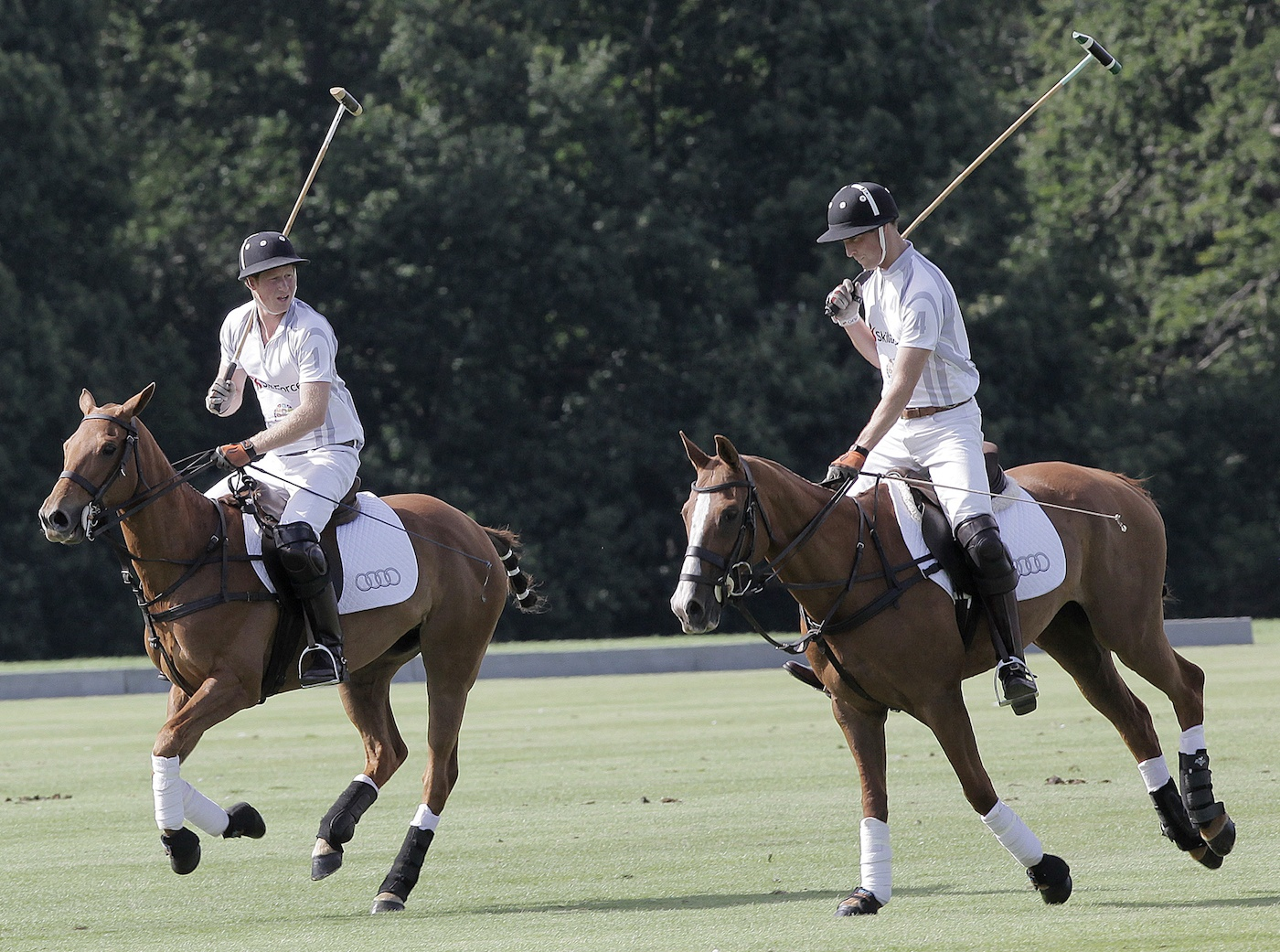 Prince Harry and Prince William playing polo