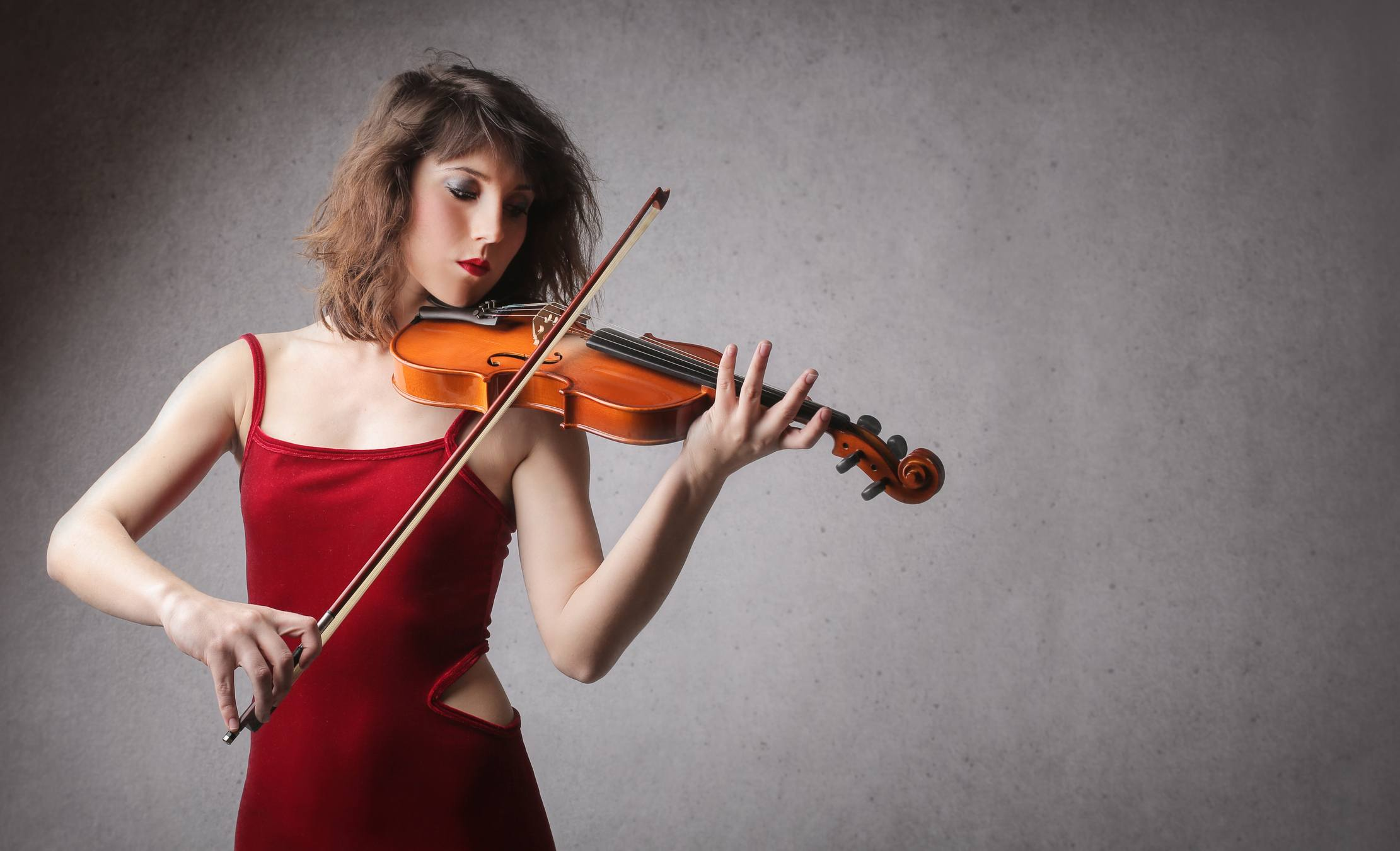 Woman in red playing Vioin