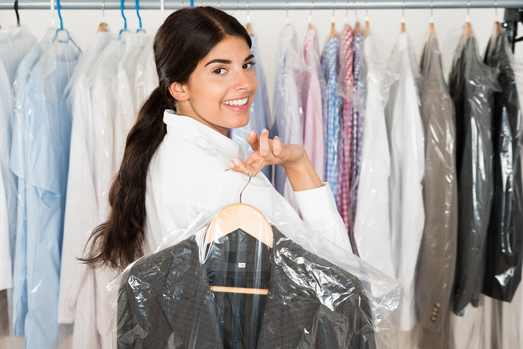 Woman With Suit In dry clean Shop