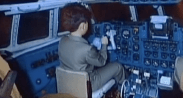 Young Kim Jong Un in the cockpit of an airplane.