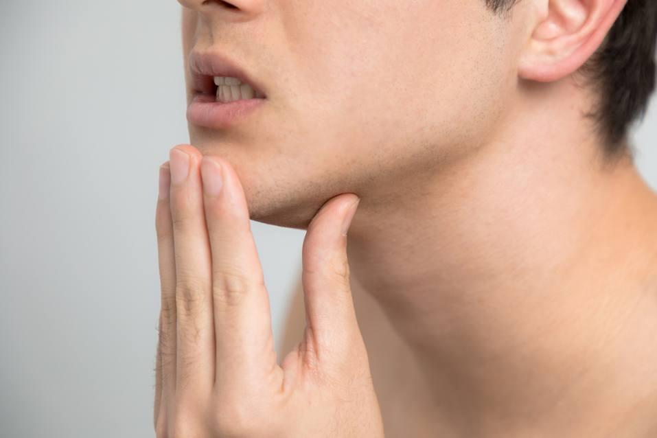 Young man checking his skin