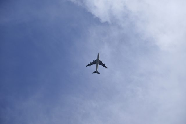 Airplane seen flying above.