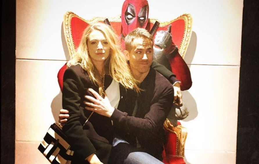 Blake Lively and Ryan Reynolds sit and pose
