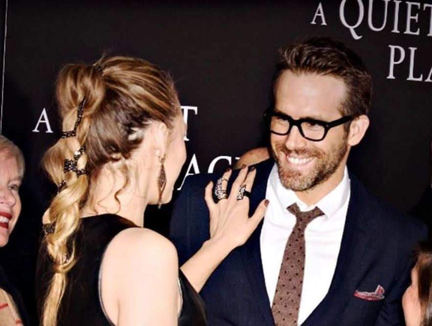 Blake Lively smiling at Ryan Reynolds