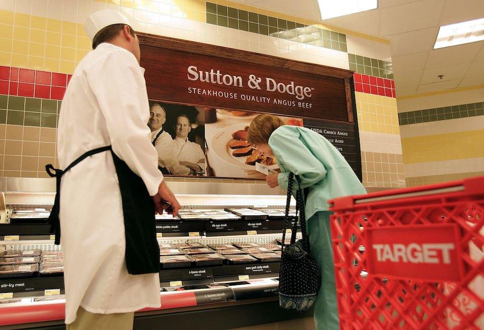 butcher helping customer