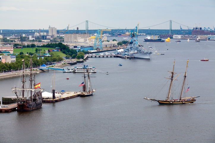 Tall sailing ships coming into port on the waterfront in Camden, New Jersey along the Delaware River