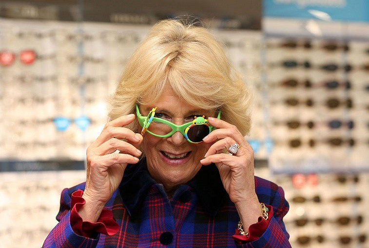 The Duchess of Cornwall tries on glasses at Boots Opticians in Peterborough during a day of visits to promote reading and storytelling as part of her role with the National Literacy Trust.