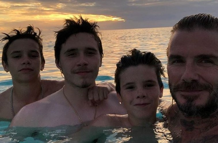 David Beckham and sons in the ocean
