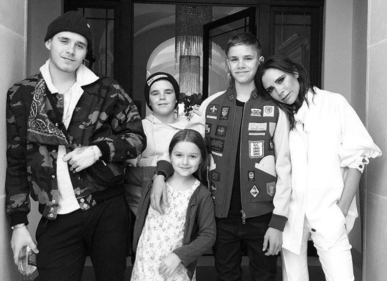 Victoria Beckham and kids in black and white