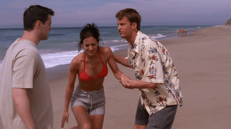 Joey, Monica, and Chandler on the beach in Friends