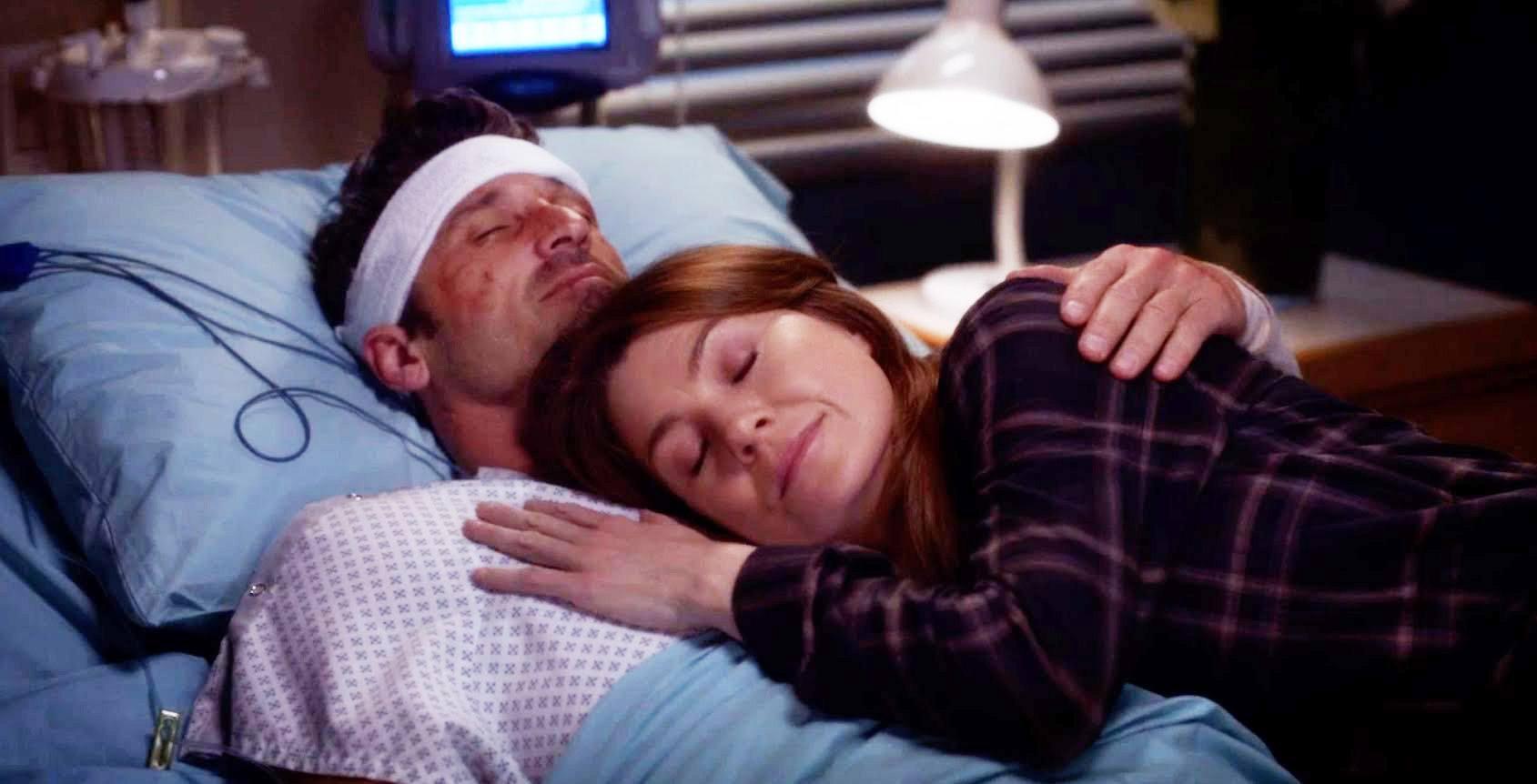 Derek holding Meredith on his death bed in Grey's Anatomy