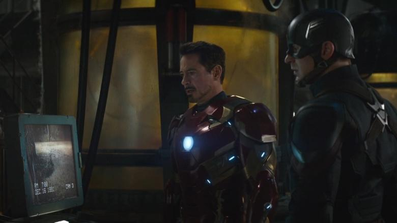 Iron Man and Captain America look at security footage