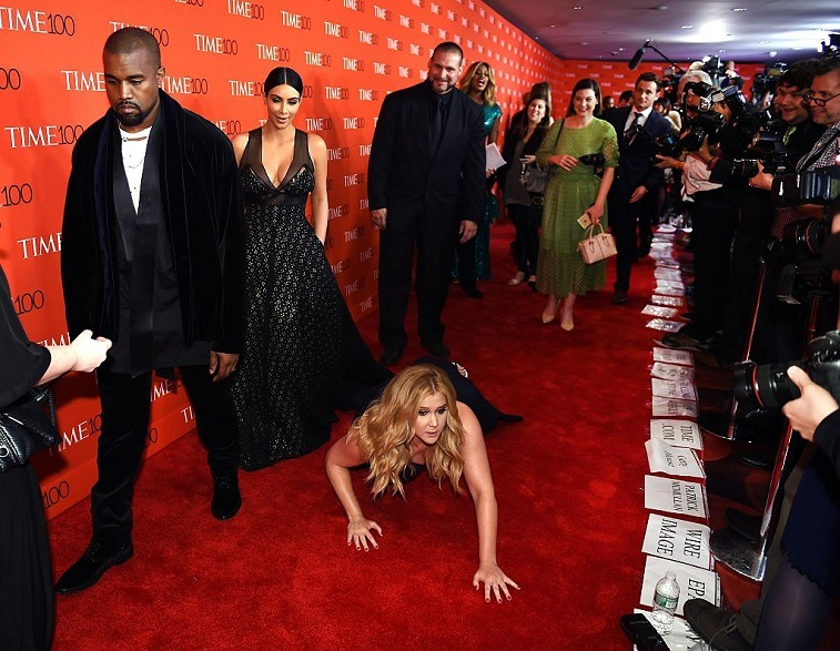 Kanye West. Kim Kardashian, and Amy Schumer on a red carpet