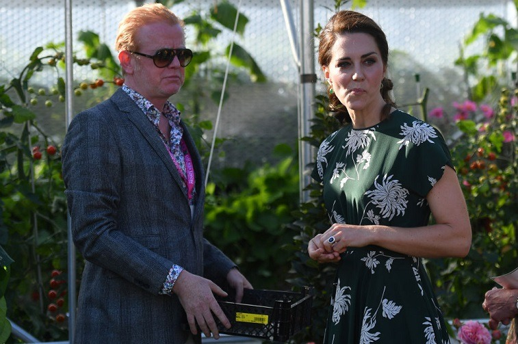 BBC Radio 2 presenter Chris Evans watches as Britain's Catherine, Duchess of Cambridge, samples a tomato at the 'BBC Radio 2: Chris Evans Taste Garden' during her visit to the Chelsea Flower Show in London on May 22, 2017.