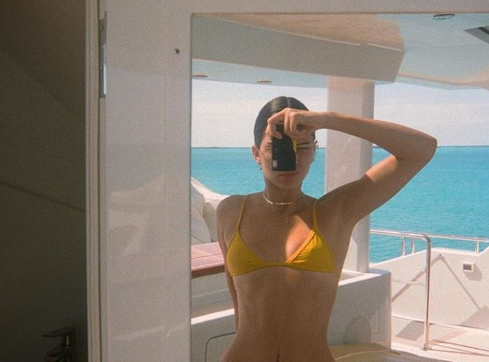 Kendall Jenner taking a photo
