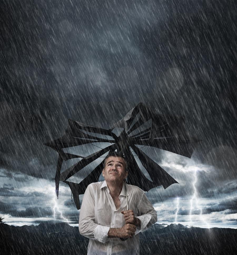 Man in rain in umberalla