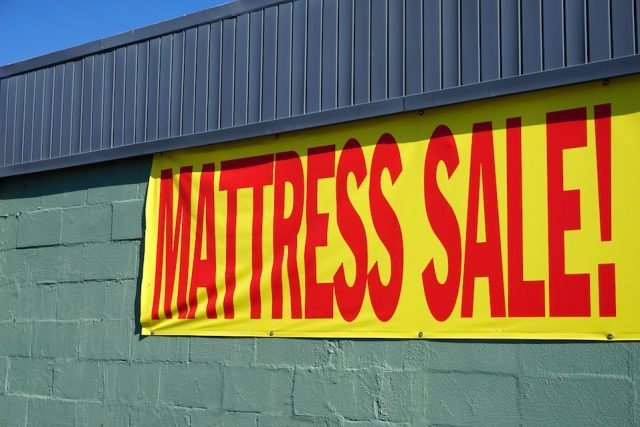 mattress sign banner hanging on store