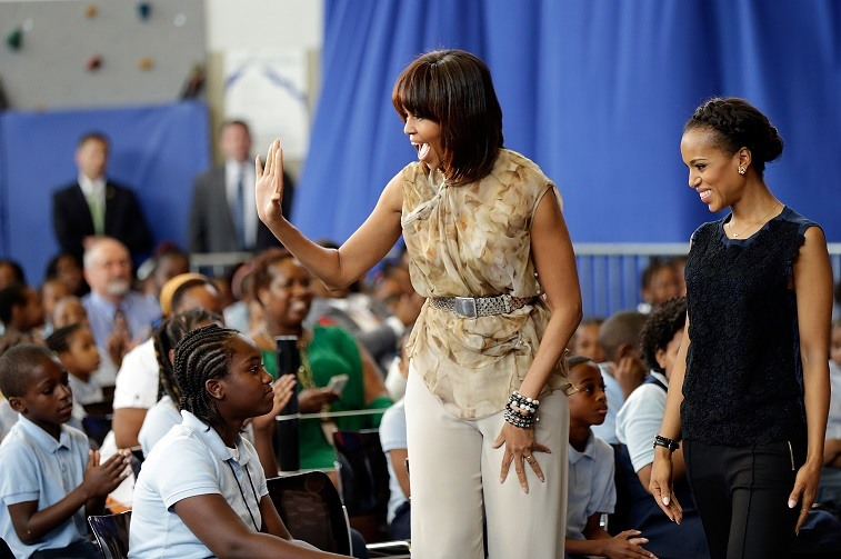 U.S. first lady Michelle Obama and actress Kerry Washington arrive for an event while visiting the Savoy School May 24, 2013 in Washington, DC.