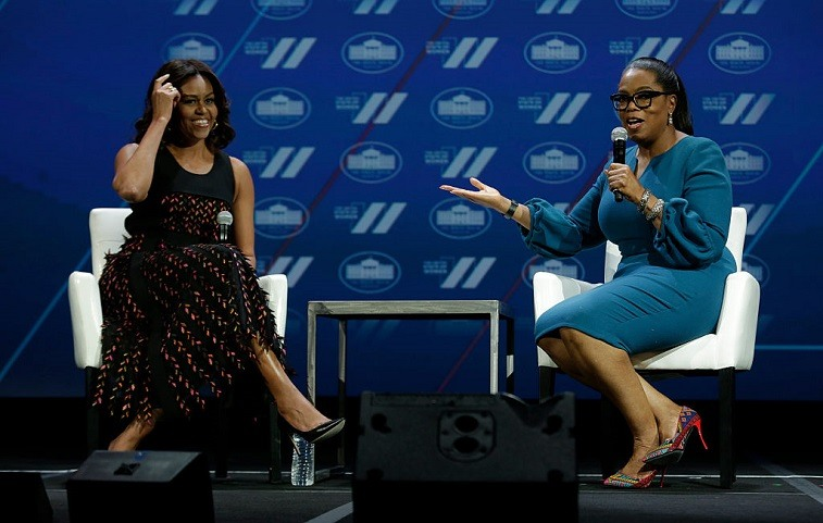 US First lady Michelle Obama (L) and Oprah Winfrey speak at the White House Summit on the United State of Women in Washington, DC on June 14, 2016.