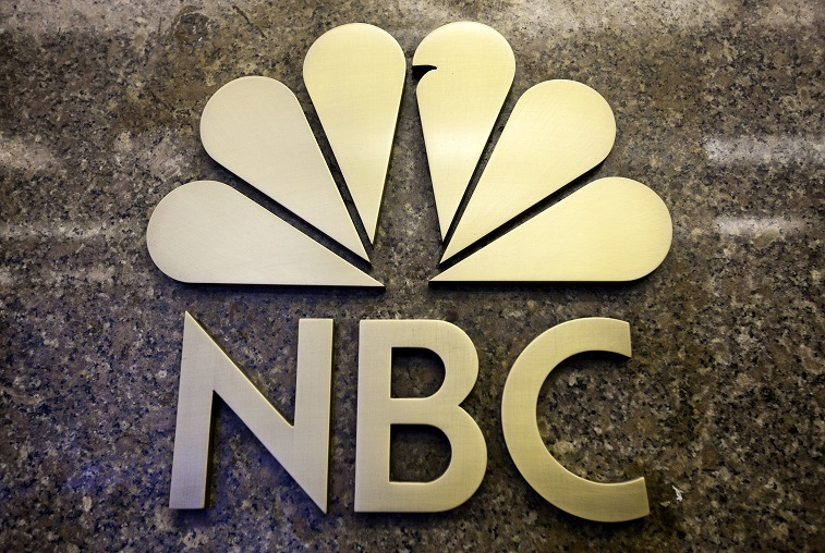 The NBC logo is seen on the entrance to NBC Studios on E 49th Street on December 1, 2009 in New York City.