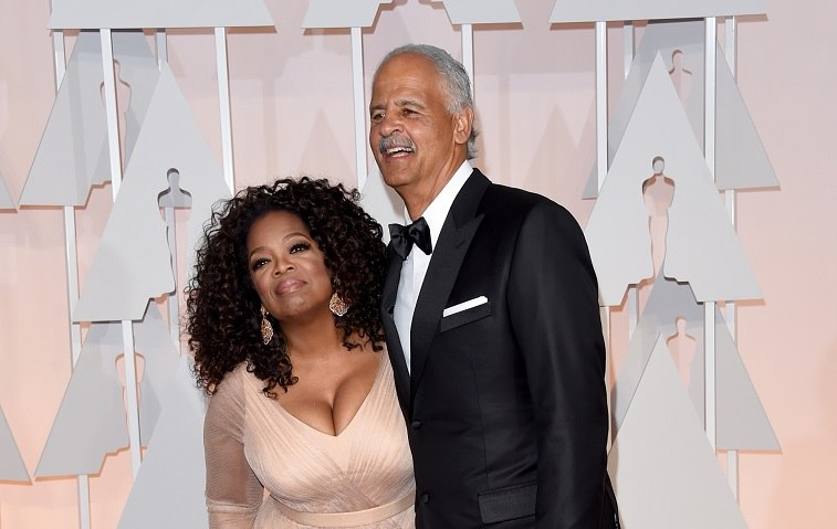 Oprah Winfrey and Stedman Graham posing on a red carpet.