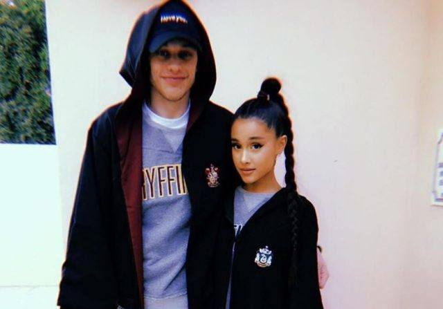 Pete Davidson and Ariana Grande wearing Hogwarts costumes.