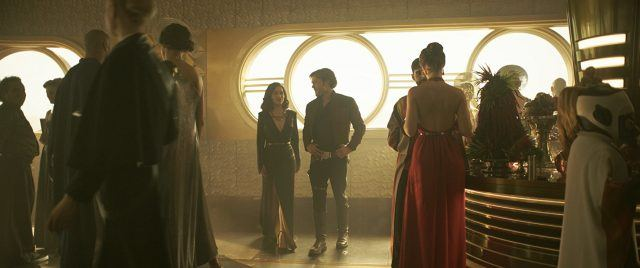Qi'ra and Han standing together at a party in 'Solo: A Star Wars Story'.