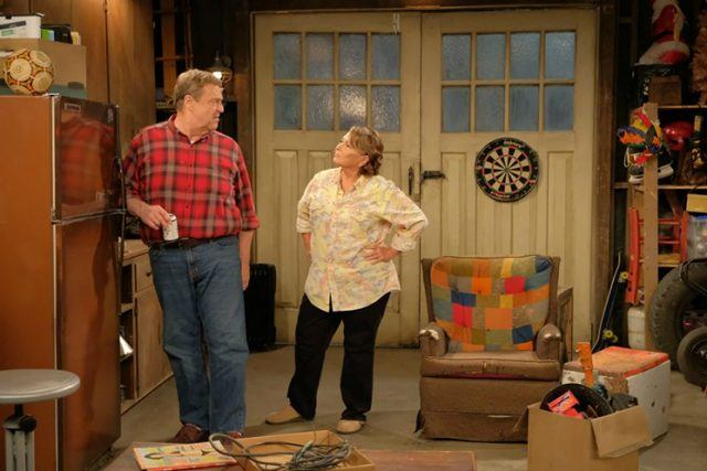 Roseanne and Dan standing in the garage.
