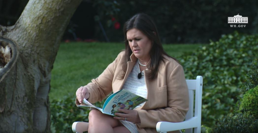 Sarah Huckabee Sanders reading a book on Easter
