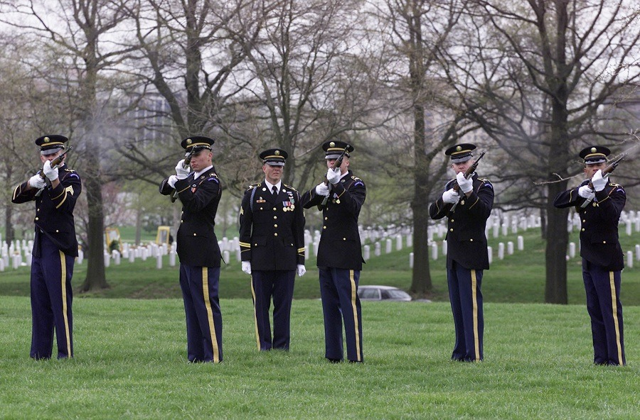 Soldiers fire a three volley salute at the funeral for Capt. Russell B. Rippetoe at Arlington National Cemetery