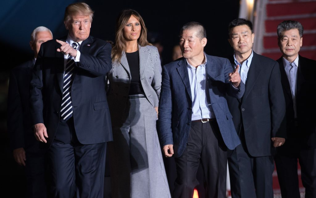 President Donald Trump and first lady Melania Trump walk with US detainees Tony Kim, Kim Hak-song,and Kim Dong-chul after they were released by North Korea at Joint Base Andrews in Maryland on May 10, 2018.