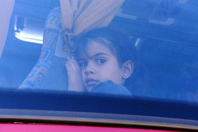 A young Syrian child on a bus.