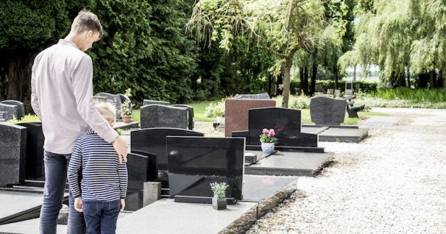 A father and son in a cemetery.