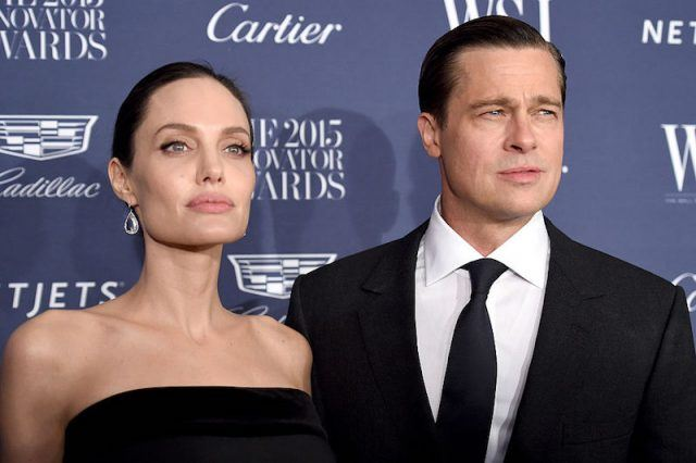 Angelina Jolie and Brad Pitt on a red carpet.