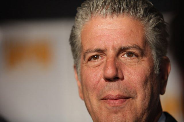 A closeup of Anthony Bourdain at an event.