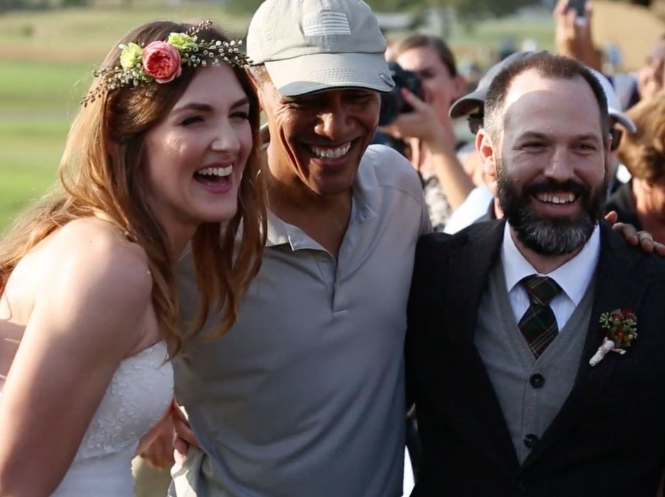 Barack Obama poses with the newlyweds.