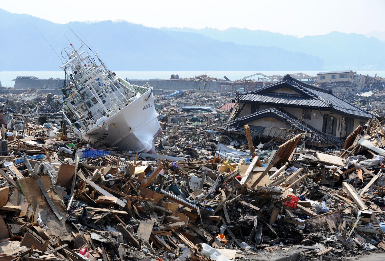 A fishing boat lies among the tsunami rubble in Japan