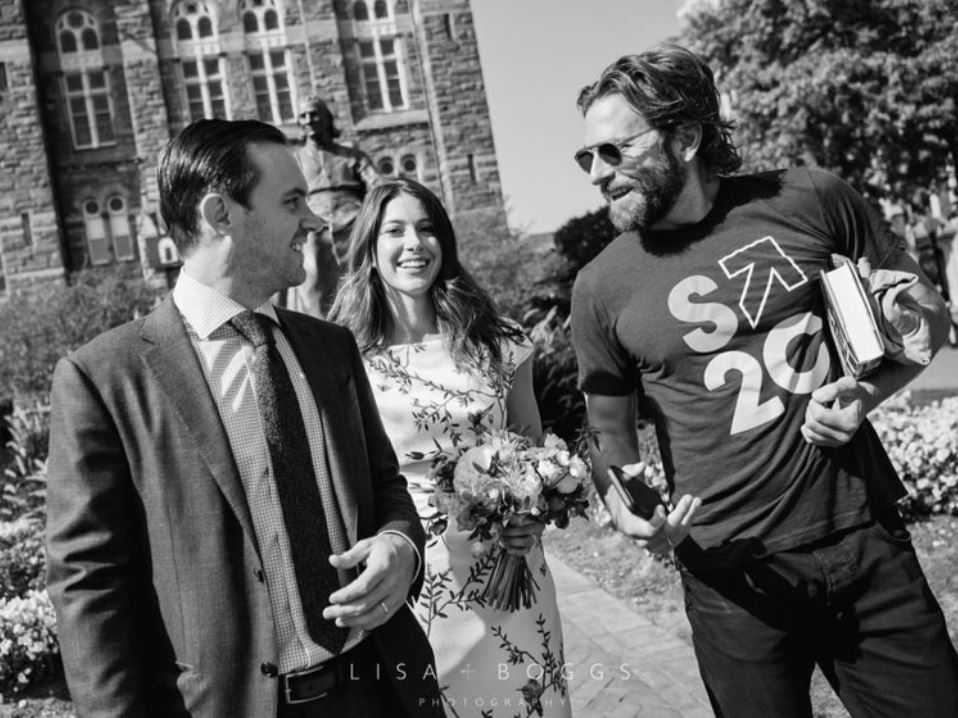 Bradley Cooper greets the bride and groom.