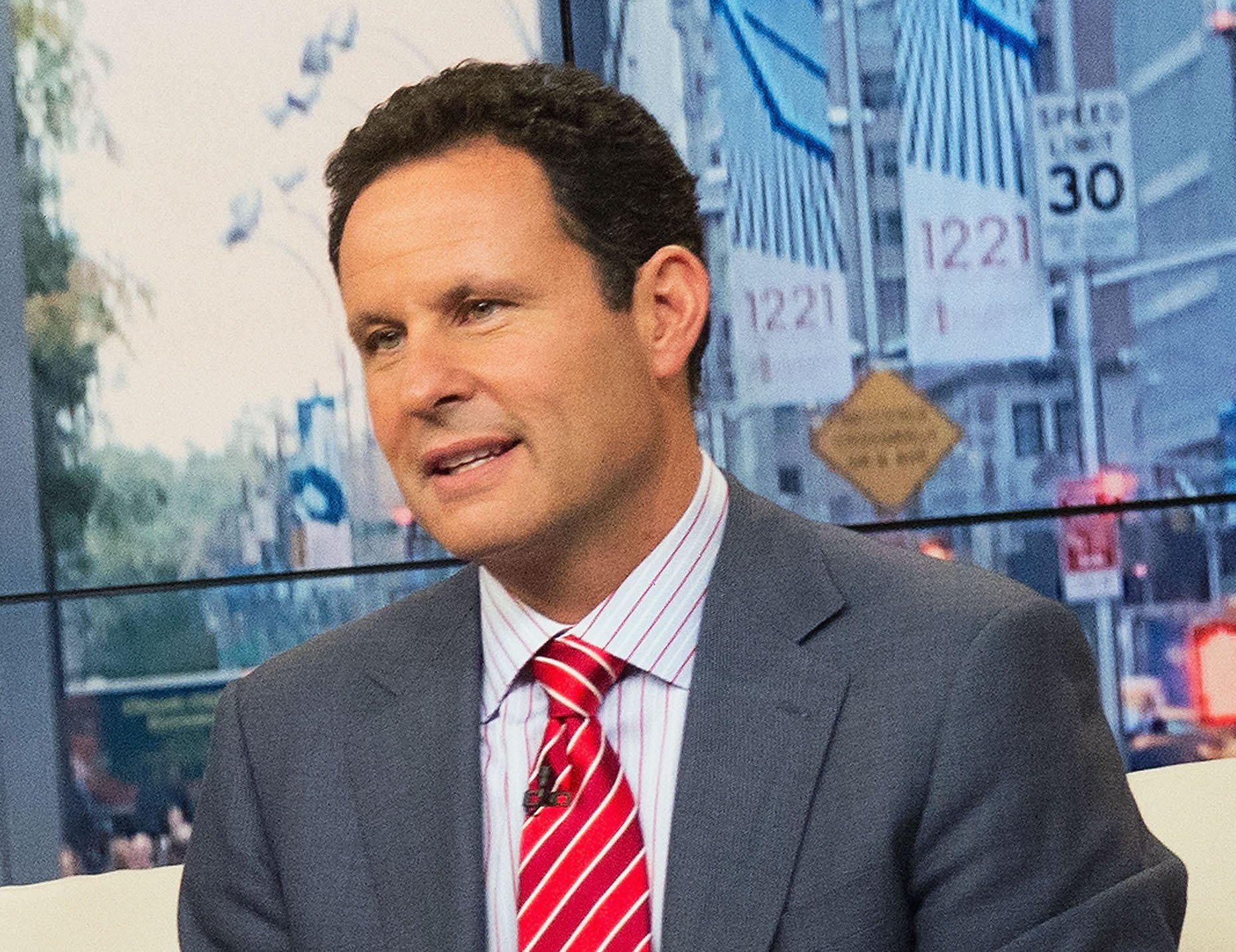 Brian Kilmeade hosts 'FOX & Friends'at FOX Studios on October 16, 2013 in New York City.