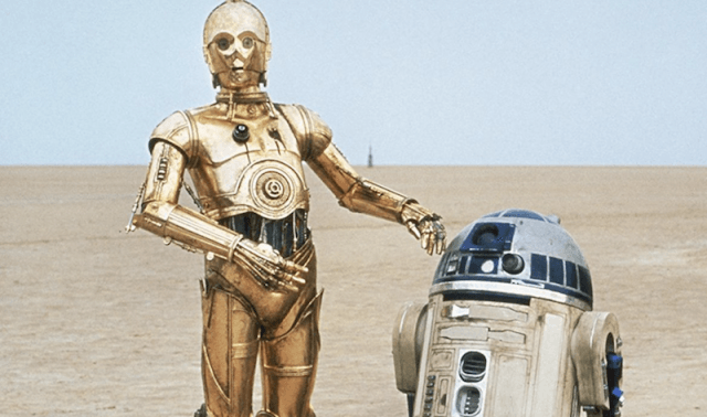 C-3PO and RD-D2 standing together.