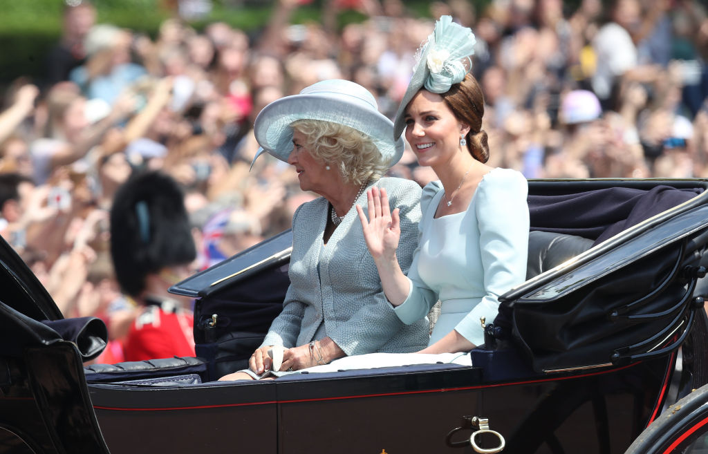 Camilla, Duchess Of Cornwall and Catherine, Duchess of Cambridge head back along the Mall to Buckingham Palace