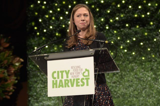 Chelsea Clinton standing behind a podium.