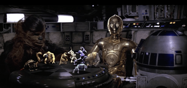 LET THE WOOKIEE WIN C-3PO and R2-D2 learn an important lesson in how to play holographic chess against Chewbacca.