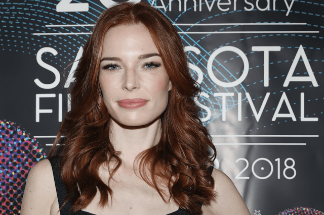 Chloe Dykstra posing on a red carpet.