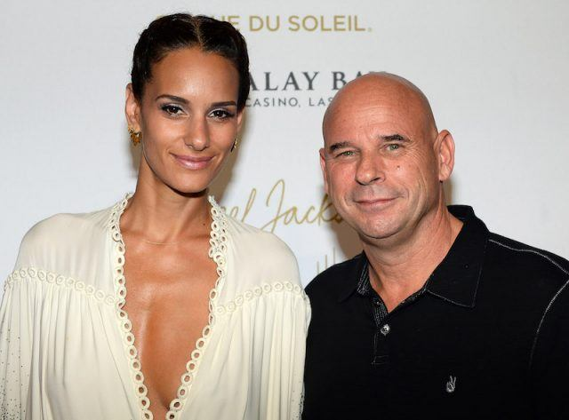 Claudia Barilla and Guy Laliberte on a red carpet.