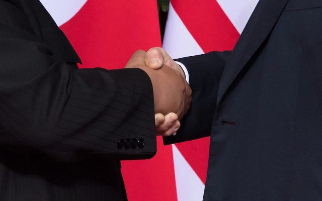 A close up of the two leaders shaking hands.