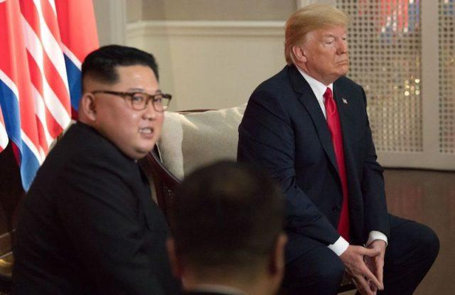 Kim Jong Un and Donald Trump sitting together at the summit.